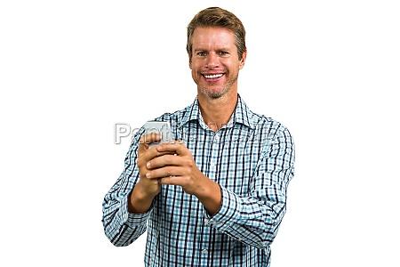 portrait of happy man using smartphone