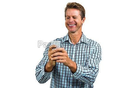 cheerful man using smartphone