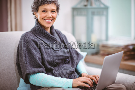 portrait of happy mature woman using