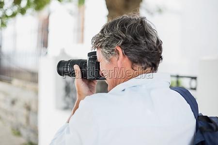 rear view of man using camera