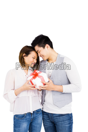 young man giving a present to