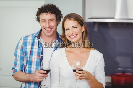 portrait of young couple holding wineglasses