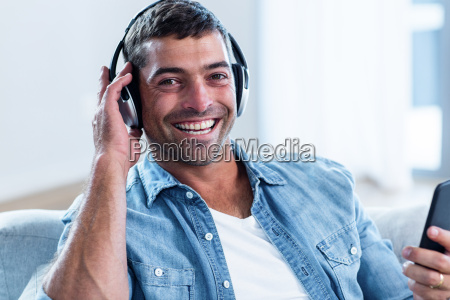 young man listening to music while