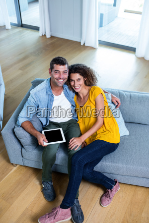 portrait young couple sitting on sofa