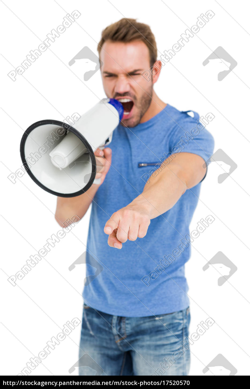 young, man, shouting, on, horn, loudspeaker - 17520570