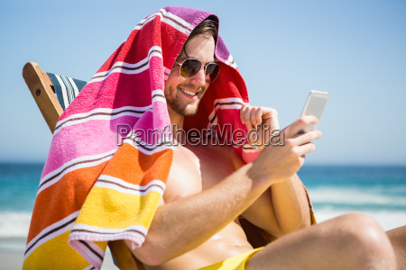 man relaxing and using smartphone