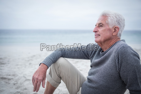 thoughtful retired man sitting on the