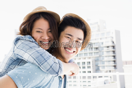 young man giving a piggyback ride