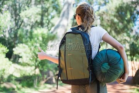 hitch hiking woman with sleeping bag