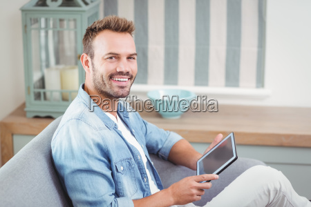 portrait of young man using tablet