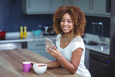 portrait of happy woman using smartphone