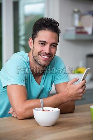 portrait of cheerful man using phone