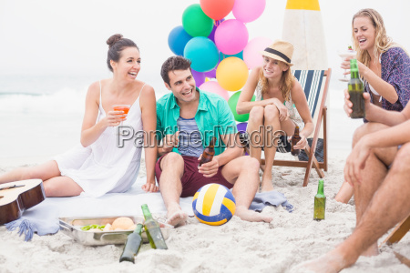 group of friends with drinks having