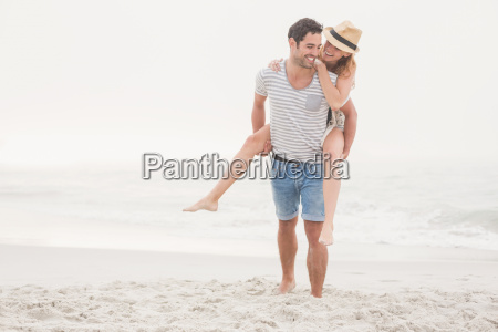 man giving a piggy back to