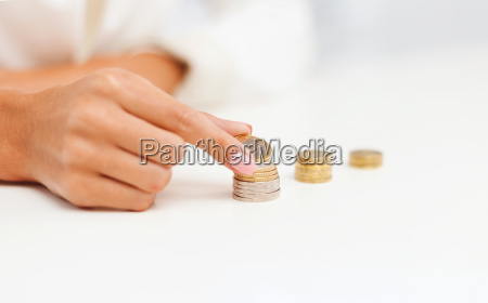 female hand putting euro coins into