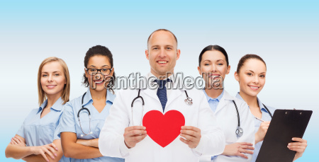 group of smiling doctors with red