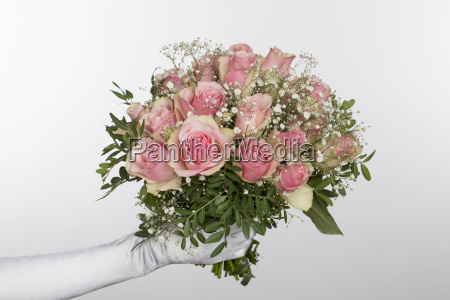 cropped hand of bride holding bouquet