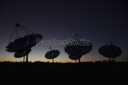solar dishes at power station against
