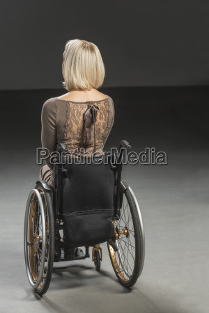 rear view of disabled woman in