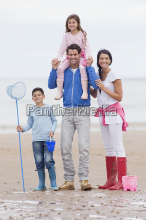 parents and children smiling together on