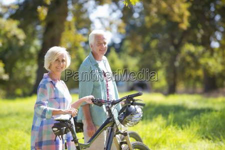 portrait of senior couple with mountain
