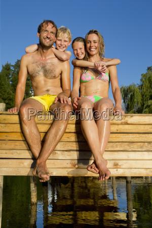 portrait of happy family sat on