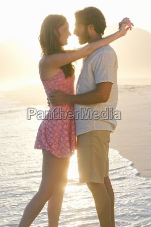 romantic couple embracing about to kiss