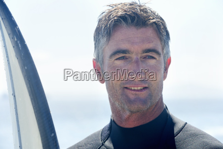 portrait of surfer with surfboard