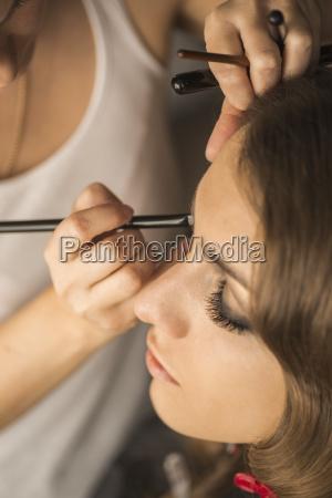 high angle view of woman applying