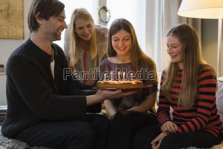 happy family with birthday cake at