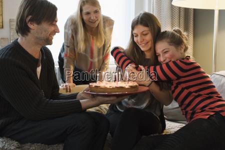 happy family celebrating a birthday at