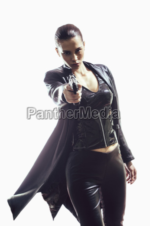 portrait of female spy aiming gun