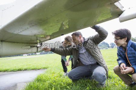 father explaining airplane parts to sons