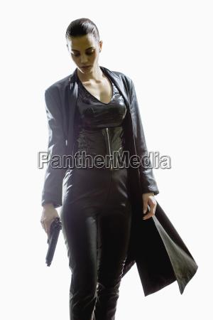 female spy holding gun while walking