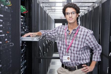 technician looking at camera replacing server