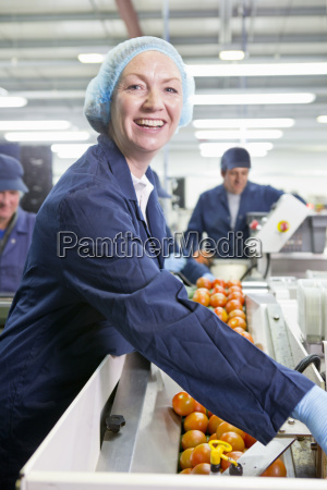 portrait smiling quality control worker checking