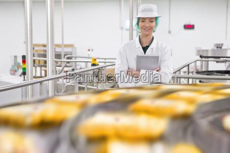 portrait confident quality control worker at