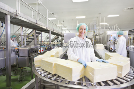 portrait smiling worker with large blocks