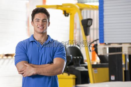 portrait of forklift truck driver smiling