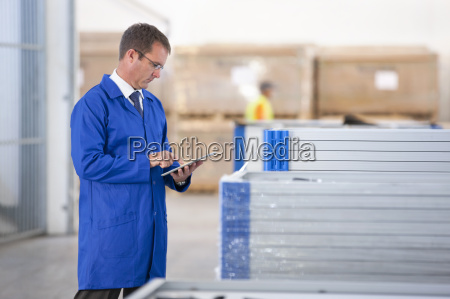 supervisor worker stock checking solar panels