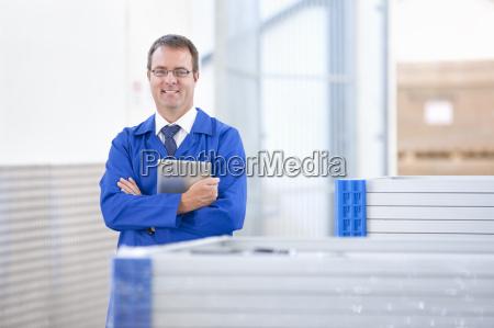 supervisor worker smiling at camera stock