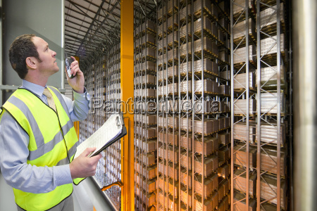 worker with walkie talkie and clipboard
