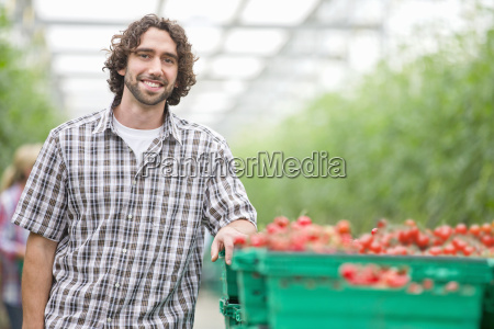 portrait smiling grower with crate of