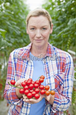 close up portrait grower holding ripe