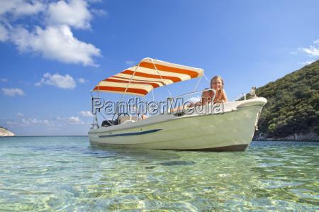 portrait smiling woman sunbathing on boat