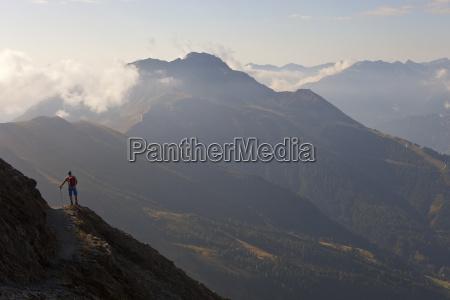a male hiker enjoys the beautiful