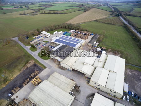 aerial view of warehouse among rural