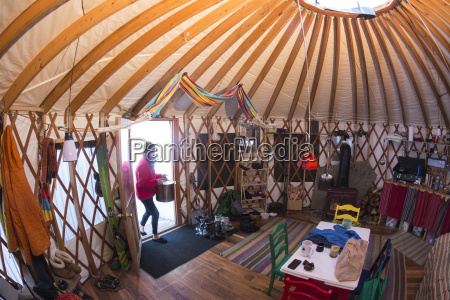 a woman in a yurt on