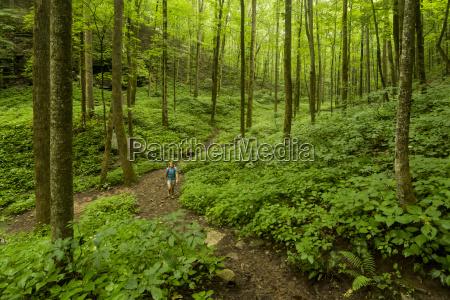 a woman hiking in virgin falls