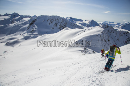 skiers at the top of a